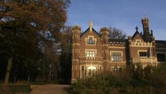 Schaffelaar castle in neo-tudor style - pan. BARNEVELD, THE NETHERLANDS - stock footage