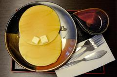pancake with butter and honey - stock photo