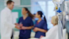 Medical staff working together and taking care of patients on a hospital ward Stock Footage