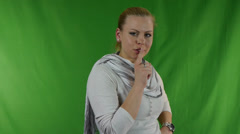 Young woman putting her finger to her lips for shh gesture - shhh secrets Stock Footage