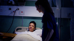 Medical team working together at night, taking care of patients on hospital ward Stock Footage