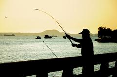 fishing man silhouette - stock photo