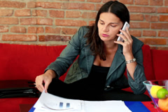 Businesswoman talking about bad results on the phone Stock Footage