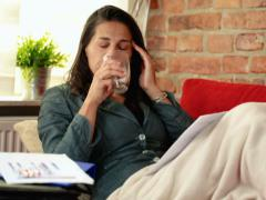 Businesswoman suffering from a headache and lying on the sofa Stock Footage