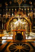 interior of the church of the holy sepulcher - stock photo