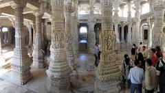 indian visitors tour the jain temple - stock photo