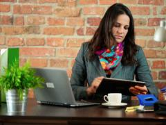 Woman working on tablet Stock Footage