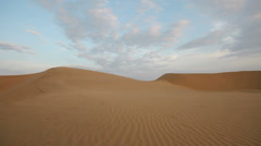 Desert dunes at sunset. Panning shot - stock footage