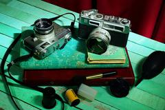 Vintage camera with old photo album, Still life - stock photo