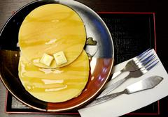 Stock Photo of pancake with butter and honey