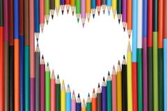 colored pencils forming a heart love topic - stock photo