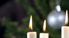 Stock Video Footage of Candlestick to Christmas decoration refocus close up