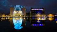 Stock Video Footage of 4K. Modern Office Buildings reflected in water. Dublin, Ireland.