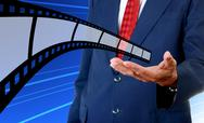 Stock Illustration of Film strip in businessman hand, Cinema industrial