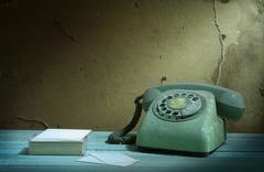 Stock Photo of retro telephone and card