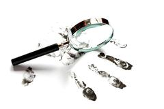 fingerprints and magnifying glass - stock photo