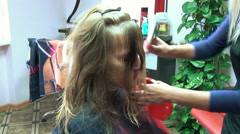 Hairdresser models woman haircut spray water on hair red bottle Stock Footage