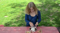 Gardener lady shell various kind decorative beans to white dish Stock Footage