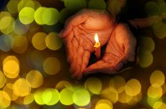 Praying with candle light - stock illustration