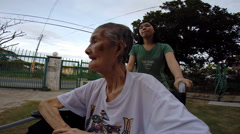 POV of old women on wheel chair moving Stock Footage