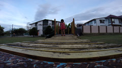 Little Girl Walk Through Wooden Bridge at Play Ground Stock Footage