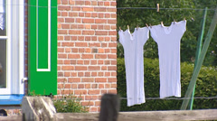 White shirts hang on laundry line to dry, Staphorst, The Netherlands Stock Footage