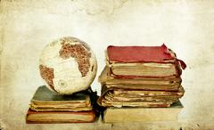 Old books and earth globe Stock Photos