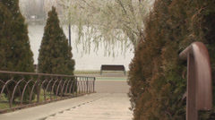 Young Woman Walks Slowly Down The Stairs In The Park Stock Footage
