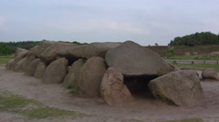 Havelte Megalithic Tomb, The Netherlands + tilt up veil cloud - stock footage