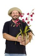 Stock Photo of Jolly florist holding orchid wicker pot