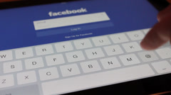 Social networking on iPad with facebook - stock footage