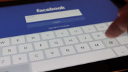 Stock Video Footage of Social networking on iPad with facebook
