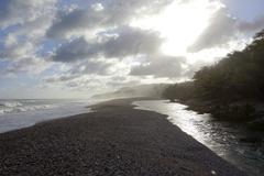 River flows to beach Stock Photos