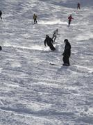 downhill skiers attack the slope - stock photo