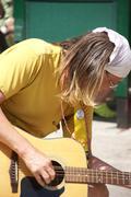 Guitar player at  street fair Stock Photos
