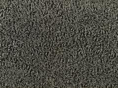 background of tangled and compressed thin steel wire. - stock photo