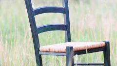 Chair in the field Stock Footage