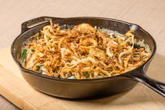 Fried onions in a cast iron skillet Stock Photos