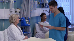 Medical staff working together and taking care of patients on a hospital ward. Stock Footage