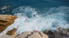 Small waves crashing on Spanish coast in the Mediterranean in Costa Brava Stock Footage
