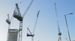 Cranes moving on blue sky Stock Footage