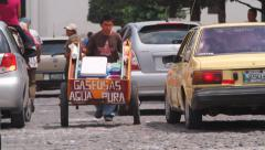 Third world country.Pushcart man on the street - Antigua Guatemala - stock footage