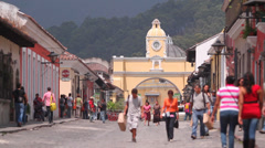 Tourist industry. Tourists on the streets of the colonial small town Stock Footage