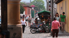 People walking on the streets of the colonial city. Antigua Guatemala Stock Footage