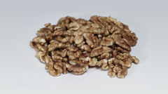 Walnuts on white turning close up Stock Footage