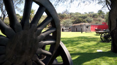 Wheel and hacienda out of focus to focus Stock Footage