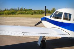 propeller air plane on runway - stock photo