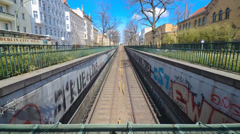 Berlin subway car going from above ground to underground in time lapse Stock Footage