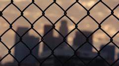Stock Video Footage of LA Skyline through Fence