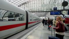 Train in Berlin's main station, the Hauptbahnhof in time lapse Stock Footage